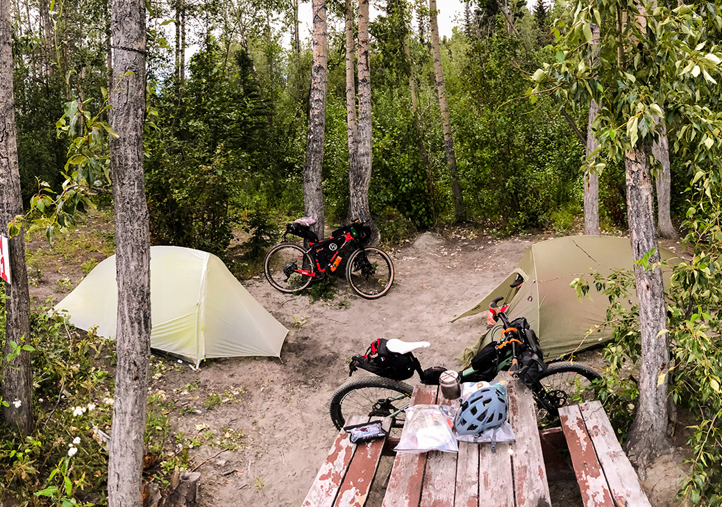 A nice campsite is a welcoming sight while bikepacking through Alaska.